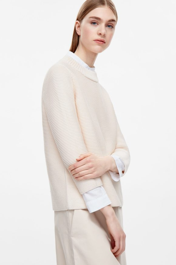 Cos Again it's all about the proportions. This Cos cotton sweater would work over jeans or a skirt like the white pleated above.