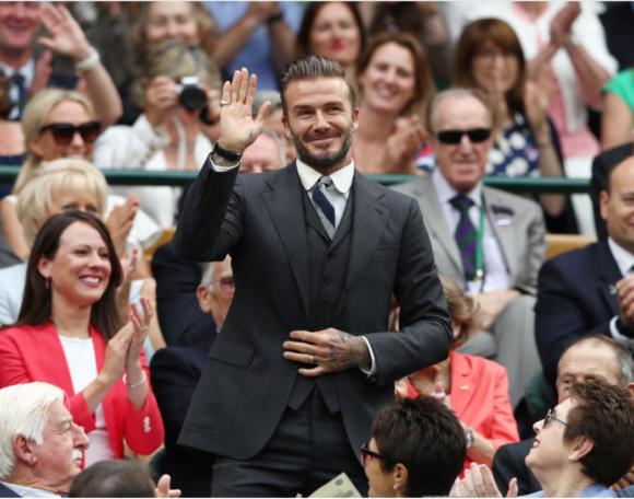 David Beckham charming the crowd at Wimbledon