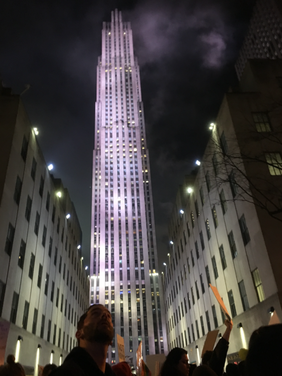 The crowd files past Rockefeller Center.