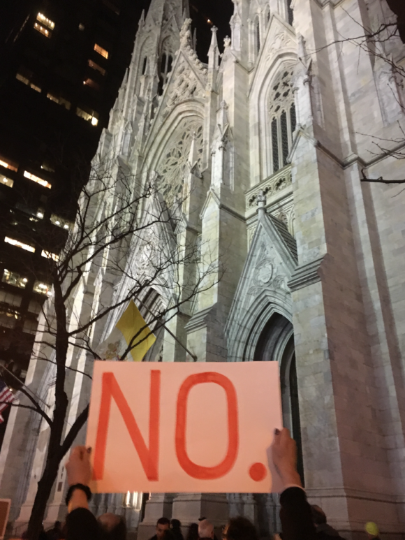 My friend's sign says it all. St Patrick's Cathedral is in the background.