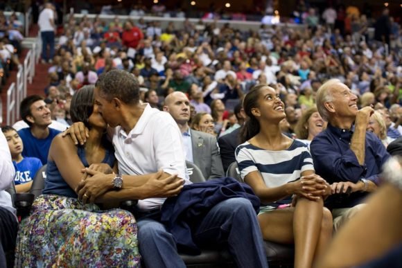 the-first-couple-smooches-for-the-kisscam-during-a-timeout-at-an-olympic-basketball-exhibition-game-in-2012