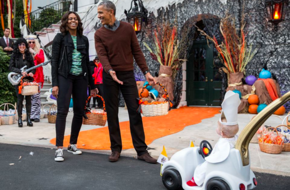 the-obamas-react-to-a-child-in-a-pope-costume-and-mini-popemobile-as-they-welcomed-children-during-a-halloween-