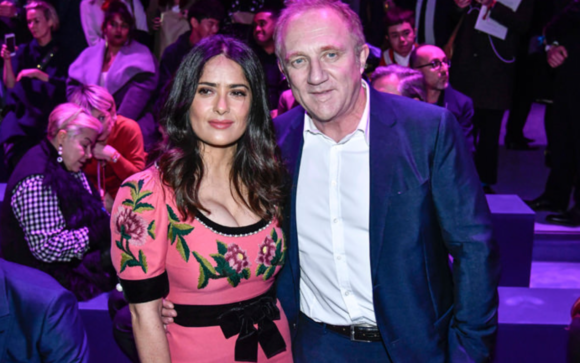 Salma Heyek with husband Francios-Henri Pinault, the CEO of Kering, at the Gucci show which is owned by Kering.